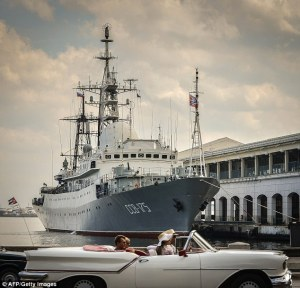 Just like old times: Tourists in a old American car pass by Russian Vishnya class warship CCB-175 Viktor Leonov, docked, on February 26, 2014, at Havana harbor (AFP/Getty Images)