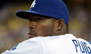 Los Angeles Dodgers right fielder Yasiel Puig watches from the dugout during a game against the San Francisco Giants. Photograph: Kirby Lee/USA Today Sports