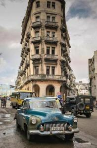 A vintage American car drives along a street in Havana in December. (ADALBERTO ROQUE/AFP/Getty Images/file)