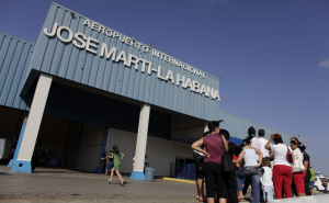People wait outside José Martí International Airport in Havana in 2009 for friends and relatives arriving from the United States. Fees levied on flights from the United States are many times higher than for any others. ASSOCAITED PRESS FILE