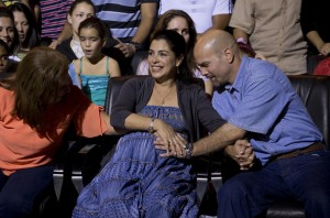 "FILE - In this Dec. 20, 2014 file photo, Gerardo Hernandez, right, member of ""The Cuban Five,"" touches the belly of his pregnant wife Adriana Perez, during a concert, in Havana, Cuba. The wife of the Cuban intelligence agent freed by the United States in December, gave birth to a girl, Tuesday, Jan. 6, 2015, after a pregnancy made possible by negotiations to improve ties between the two countries. U.S. officials helped facilitate a process of artificial insemination for Hernandez and his wife. (Ramon Espinosa, File/Associated Press)"