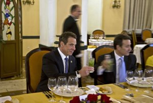 New York Governor Andrew Cuomo toasts with a mojito during a meeting at the Hotel Nacional in Havana, Cuba, Monday, April 20, 2015. Cuomo is the first U.S. governor to visit Cuba since the Dec. 17 declaration of detente. At right is Gustavo Machin, Cuba's deputy chief of North American affairs.(AP Photo/Ramon Espinosa,Pool) The Associated Press