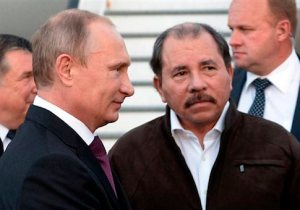 Nicaragua's President Daniel Ortega, right, and Russian President Vladimir Putin, left, attend a welcome ceremony at an airport in Managua, Nicaragua, Friday, July 11, 2014. (AP Photo/RIA-Novosti, Alexei Nikolsky, Presidential Press Service)