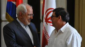 Iran's Foreign Minister Mohammad Javad Zarif (L) shakes hands with his Cuban counterpart Bruno Rodriguez on arrival at the Foreign Ministry building in the Cuban capital of Havana, August 22, 2016. (Photo by AFP)