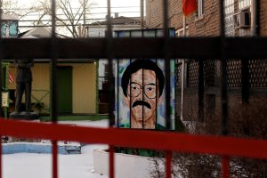 A painting of Oscar Lopez Rivera in Humboldt Park in Chicago in 2011. (Credit: Sally Ryan for The New York Times)